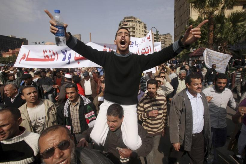 A protester gestures during an anti-Mubarak protest in Cairo