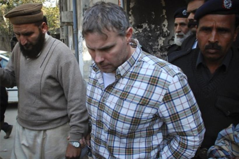 Raymond Davis is escorted by police and officials out of court after facing a judge in Lahore, January 28, 2011