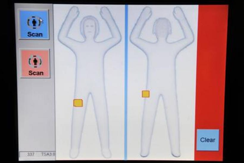 Image of a passenger appears on the screen as Transportation Safety Administration employees demonstrate new body scanner software in Arlington, Virginia