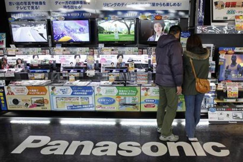 A couple look at Panasonic Corp's Viera TVs displayed at an electronics store in Tokyo