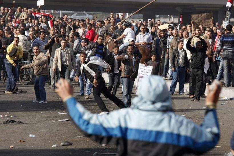 Pro and anti-Mubarak supporters clash during rioting at Tahrir Square in Cairo February 2, 2011. Opponents and supporters of Egypt's President Hosni Mubarak fought with fists, stones and clubs in Cairo on Wednesday in what appeared to be a move by forces