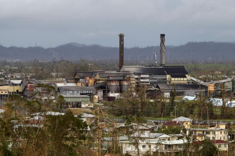 A sugar processing plant stands in the middle of destruction