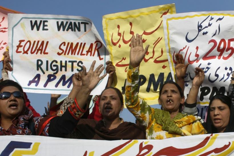 Protesters hold up placards while demanding the release of Asia Bibi, a Pakistani Christian woman sentenced to death for blasphemy, at a rally in Faisalabad