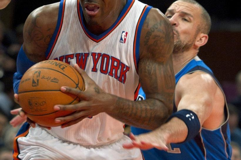 Dallas Mavericks guard Jason Kidd tries to steal the ball from New York Knicks center Amar'e Stoudemire (L) in the second quarter of their NBA basketball game at Madison Square Garden in New York, February 2, 2011.