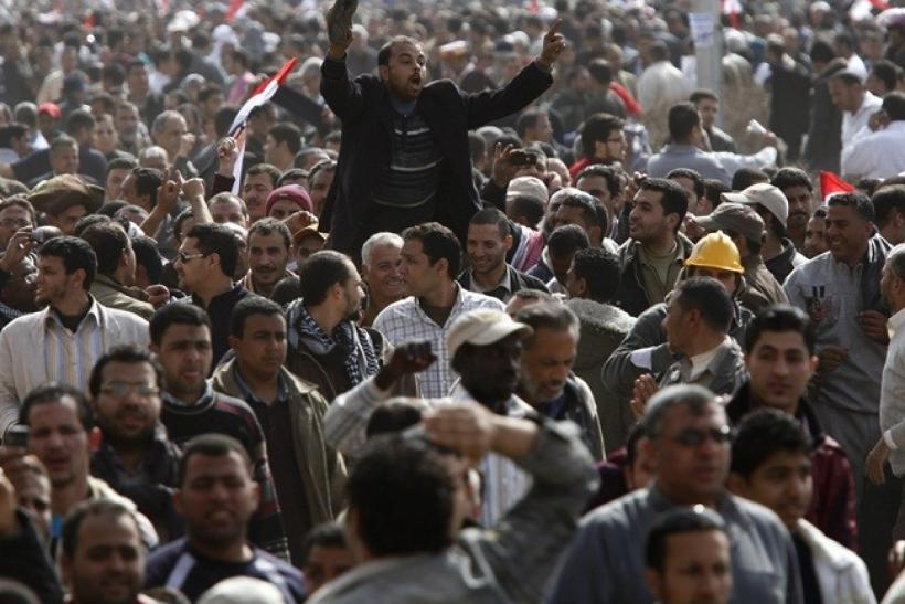 An opposition supporter waves his shoe, a sign of disrespect, shortly after Friday prayers in Tahrir Square in Cairo February 4, 2011.