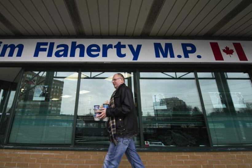 Sid Ryan, president of the Ontario Federation of Labour, brings coffee to union members occupying Finance Minister Jim Flaherty's office in Whitby