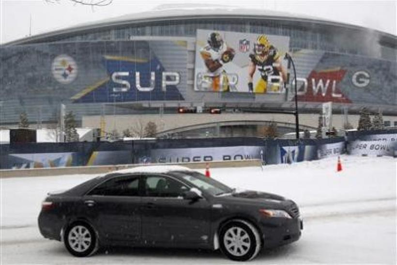 Snow falls around Cowboy Stadium in Arlington, February 4, 2011.