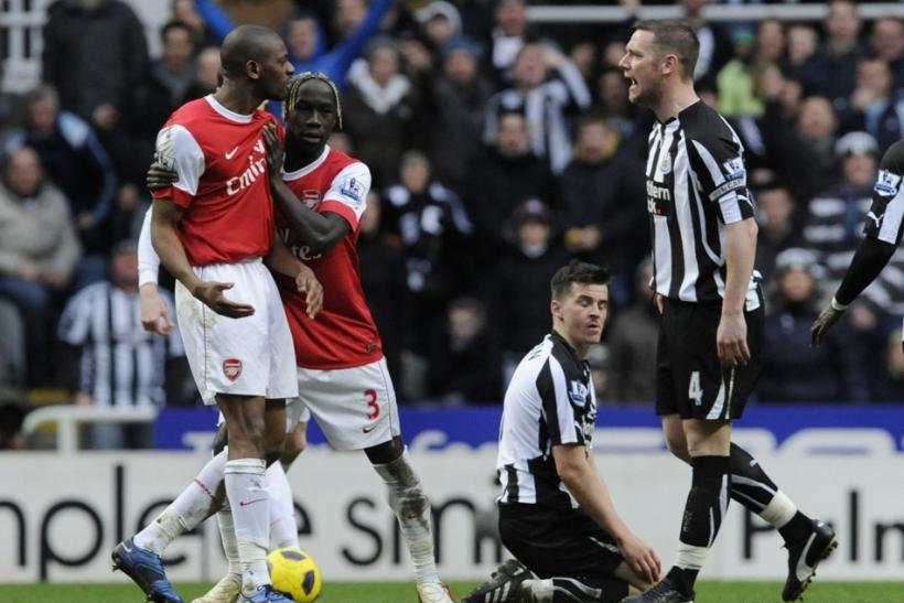 Arsenal's Diaby reacts to Newcastle United's Nolan and sent off during their English Premier League soccer match in Newcastle.