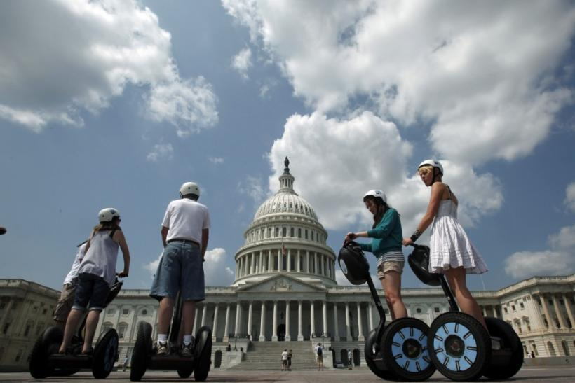 A group of tourists on Segway personal transporters take a guided tour of Capitol Hill in Washington. Americans surveyed seemed to suggest that the economy-rattled, notoriously isolationist Americans are set to take to the road more during 2011.