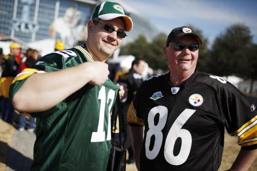 Packers fan faces off with a Steelers fan outside the stadium before the NFL's Super Bowl XLV football game in Arlington