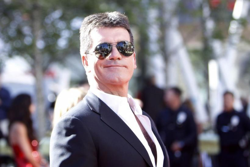 Judge Simon Cowell arrives for the 9th season finale of 'American Idol' in Los Angeles