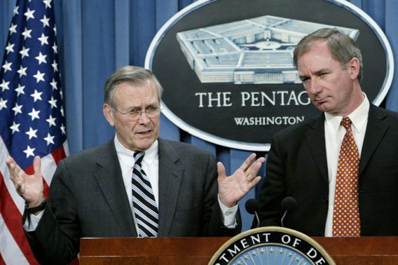 U.S. Secretary of Defense Donald Rumsfeld (L) holds a press conference with British Defense Minister Geoff Hoon (R) at the Pentagon February 12, 2003.