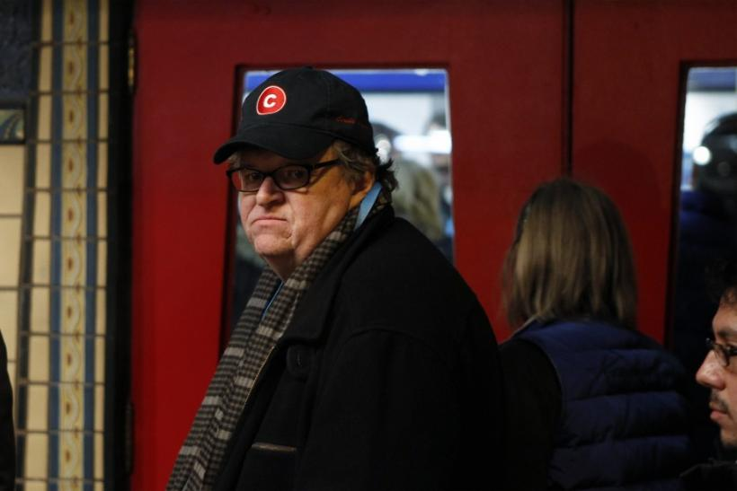 Director Moore walks into a theater during the Sundance Film Festival in Park City, Utah