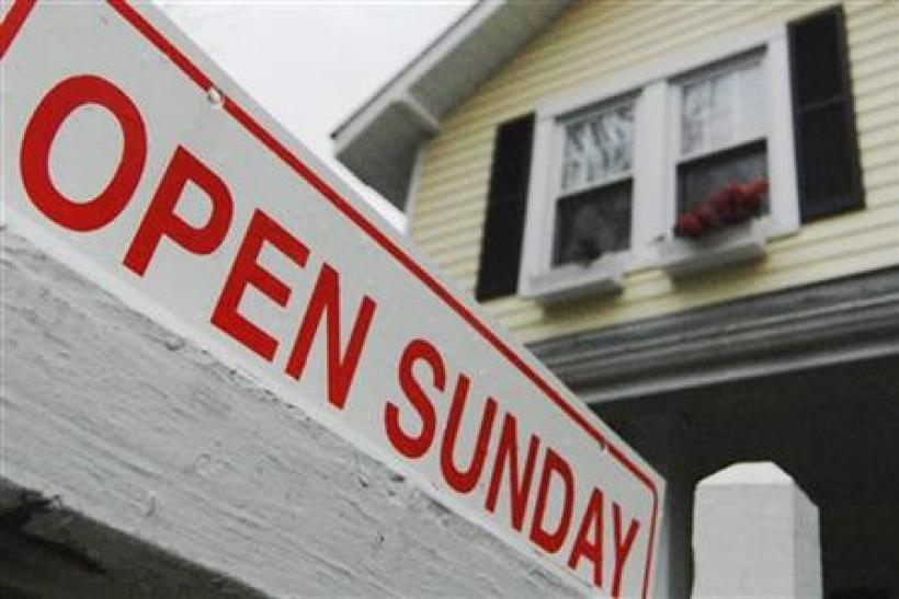 A sign advertises an open house for sale in Alexandria, Virginia April 6, 2008.