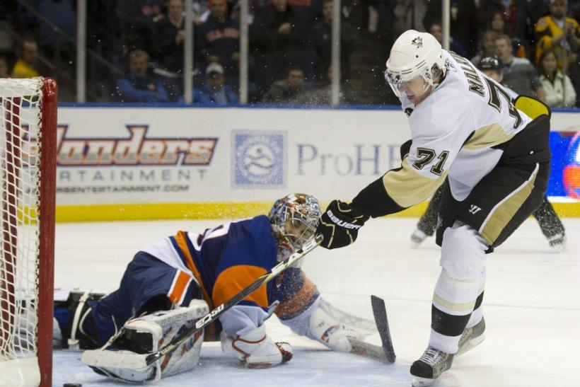 Pittsburgh Penguins center Malkin scores past New York Islanders goalie DiPietro in a shootout in Uniondale, New York.