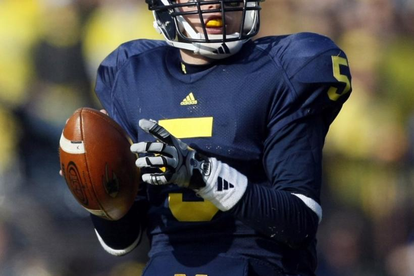 University of Michigan quarterback Tate Forcier looks for his receiver during the second half of their NCAA football game against Ohio State in Ann Arbor, November 21, 2009.