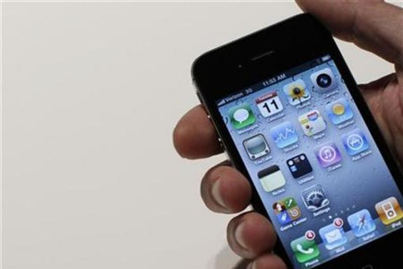 An Apple staff demonstrates a new Verizon iPhone 4 at Verizon's iPhone 4 launch event in New York