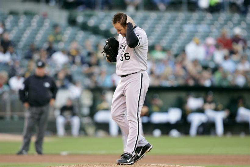 Chicago White Sox Mark Buehrle rubs his head as he walks on the mound in the third inning of their MLB American League baseball game against the Oakland Athletics in Oakland, California July 23, 2010.