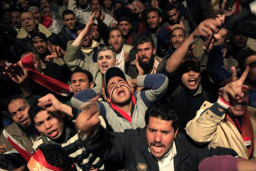 Opposition supporters shout in their stronghold of Tahrir Square