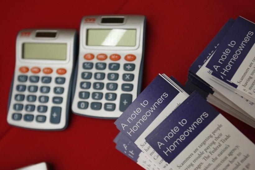Flyers are stacked beside calculators at the Housing Fair put on by the National Urban League's Economic Empowerment Tour in Dallas, Texas June 13, 2009.