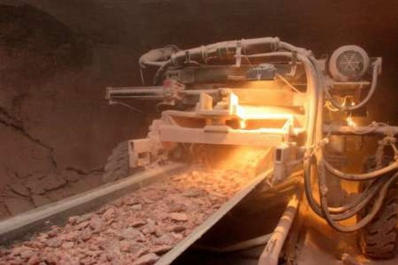 Potash drilled from the earth is carried up to the surface on a conveyor belt