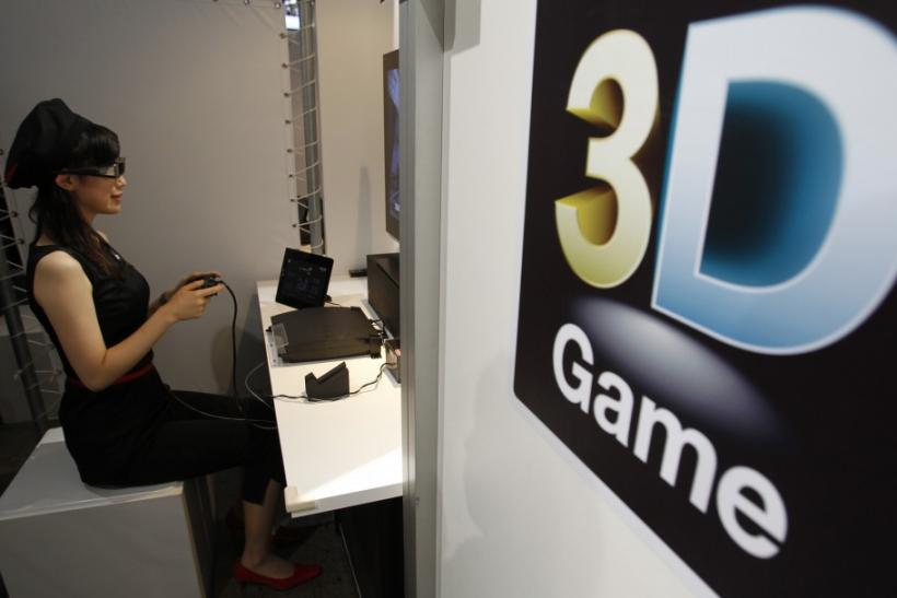 An attendant demonstrates Sony's 3D game on the PlayStation 3 game console at Tokyo Game Show in Chiba