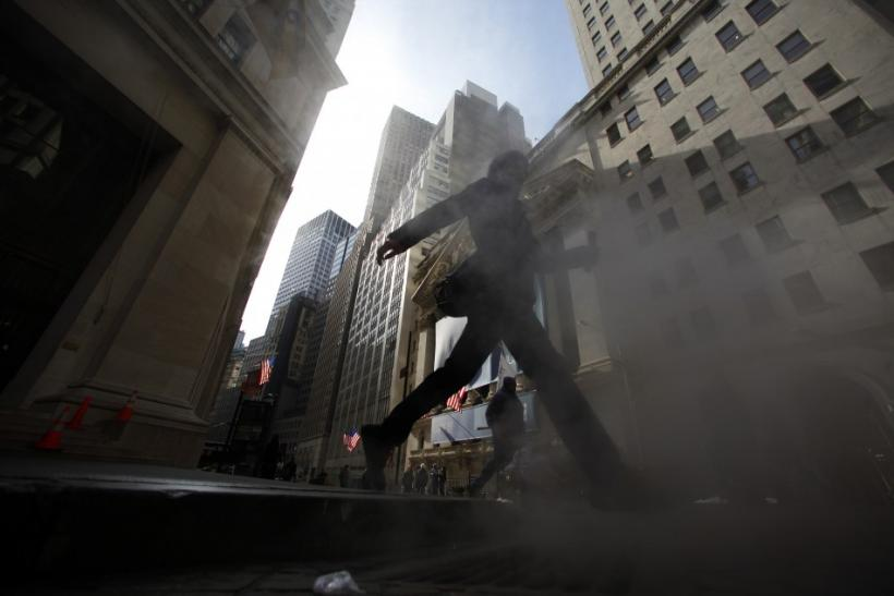 A man walks near the NYSE in New York