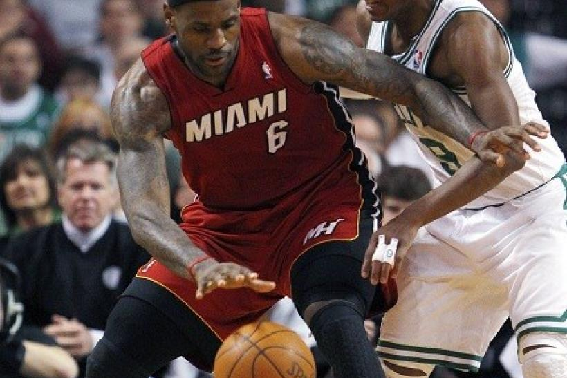 LeBron James is guarded tightly by Rajon Rondo