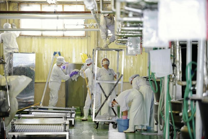 Workers clean at a school meal kitchen in Iwamizawa