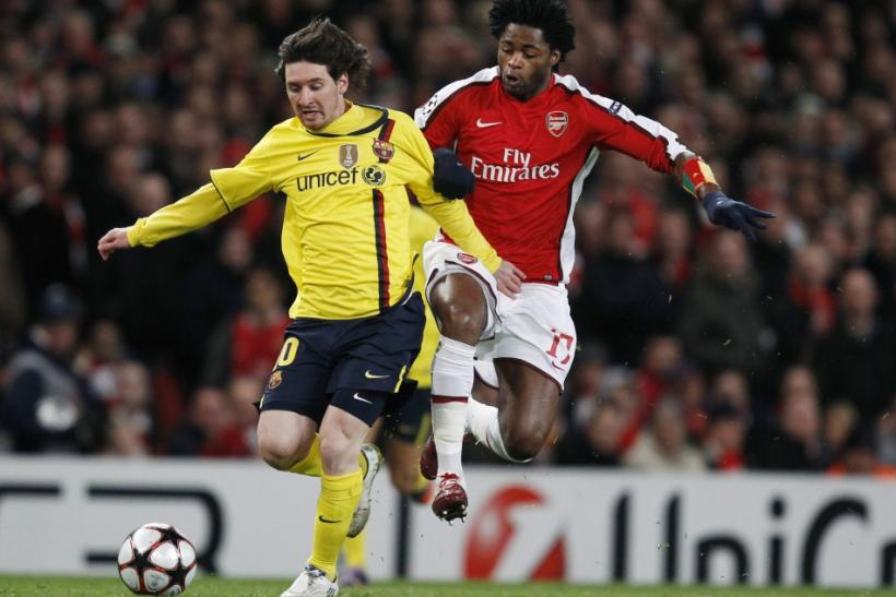 Arsenal's Song challenges Barcelona's Messi during their Champions League quarter-final soccer match in London.