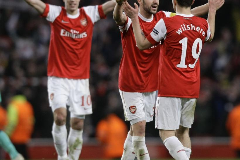 Arsenal's van Persie, Fabregas and Wilshere celebrate their victory against Barcelona after their Champions League soccer match in north London.