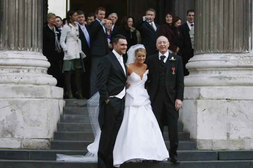 Actress Davis stands with husband Yeoman and father Carrot outside St. Paul's Cathedral after her wedding in London