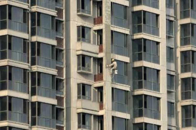 China tightening to hit small property firms -Fitch