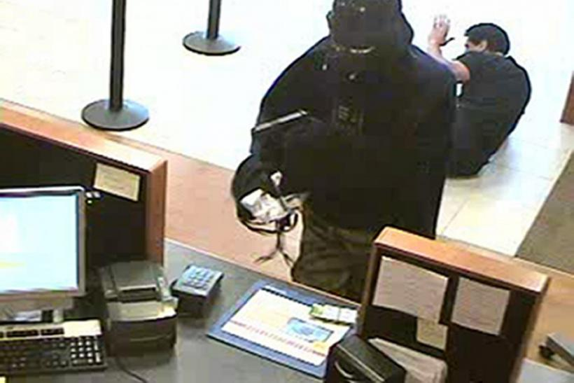 An unidentified man dressed as Darth Vader is seen robbing a Chase bank branch in Setauket.