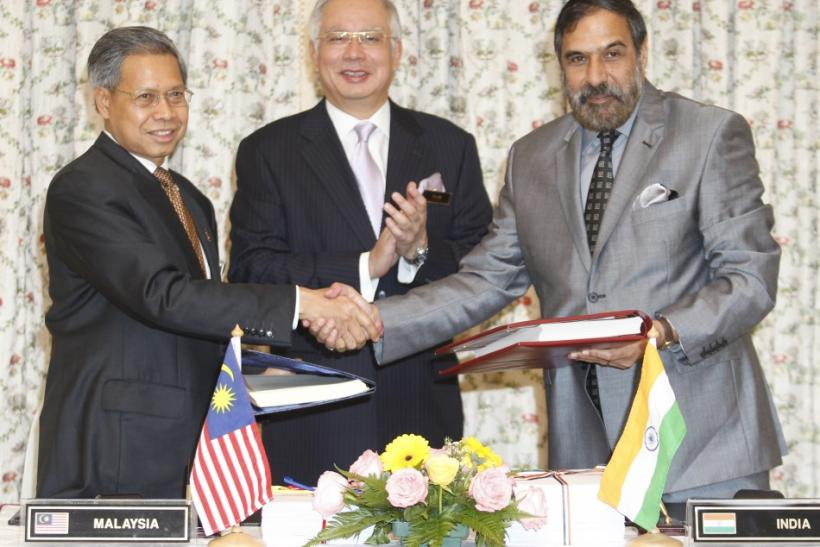Malaysia and India, two of emerging Asia's robust economies, signed a Comprehensive Economic Cooperation Agreement (CECA) on Friday, aiming to boost bilateral trade to the tune of $15 billion by 2015.