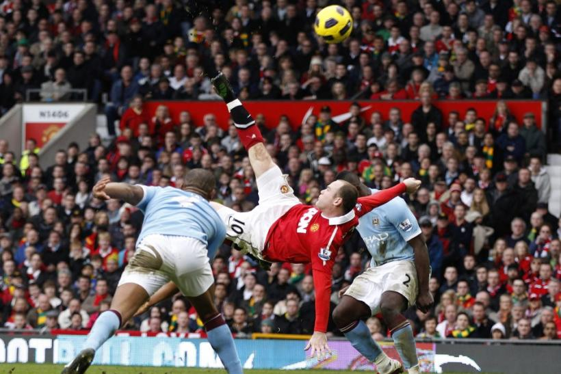 Manchester United's Wayne Rooney scores against Manchester City from an overhead kick during their English Premier League soccer match at Old Trafford in Manchester, northern England.