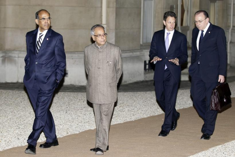 India's Central Bank Governor Subbarao , India's Finance Minister Mukherjee, U.S. Treasury Secretary Geithner and Bundesbank President Weber arrive at the Hotel Marigny to attend the dinner of G20 finance ministers and central bank governors in Paris