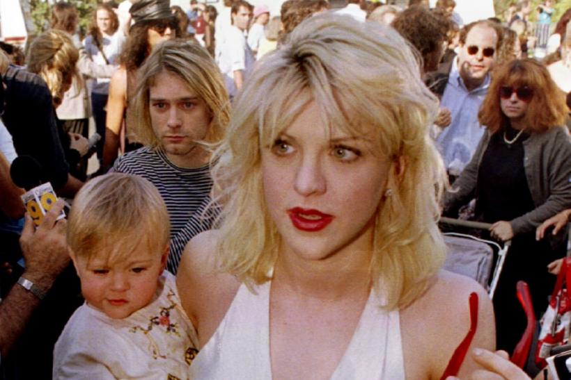 FILE PHOTO SEP '92- Kurt Cobain (L, behind baby), is shown as he arrives with wife Courtney Love, holding their daughter Frances Bean Cobain, for the MTV Music Awards show in September 1992 in Los Angeles