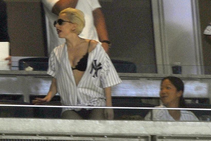 Singer Lady Gaga watches the New York Yankees play the New York Mets in the fourth inning of their MLB inter-league baseball game at Yankee Stadium in New York, June 18, 2010.