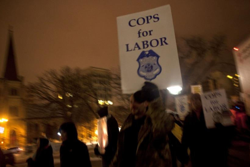 Police officers show their support for fellow union workers as they march around the state Capitol in Madison in protest against Republican Governor Scott Walker's proposed legislation