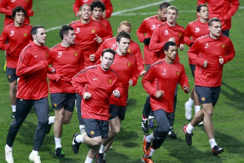 Manchester United's players run during a training session in Marseille.