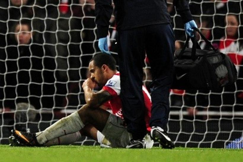 Walcott hurts in ankle in the second half