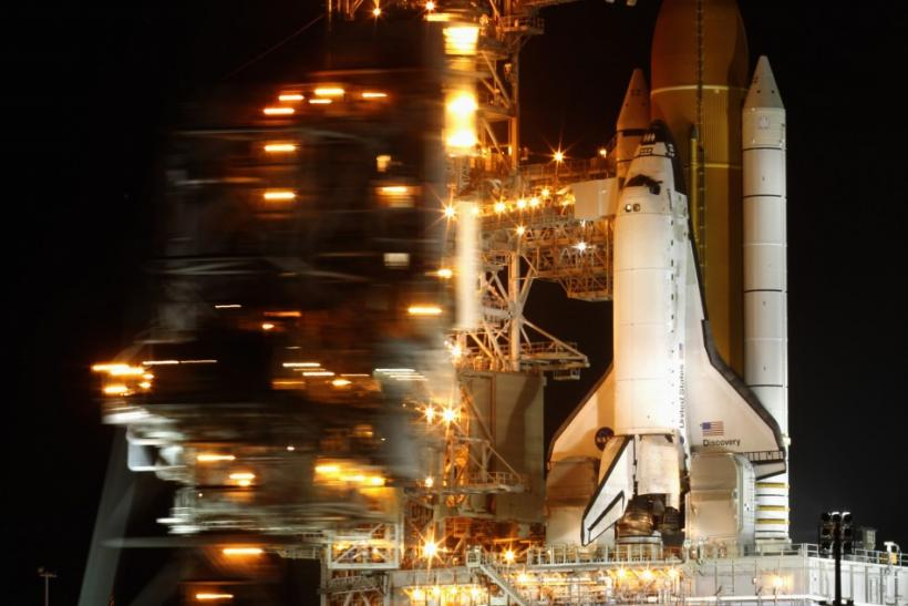 The space shuttle Discovery is prepared for launch as the Rotating Service Structure is rolled back at launch pad 39A, at the Kennedy Space Center in Cape Canaveral