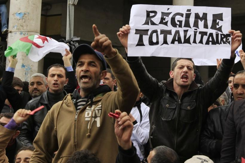 Anti-government protesters chant slogans during a demonstration in Algiers