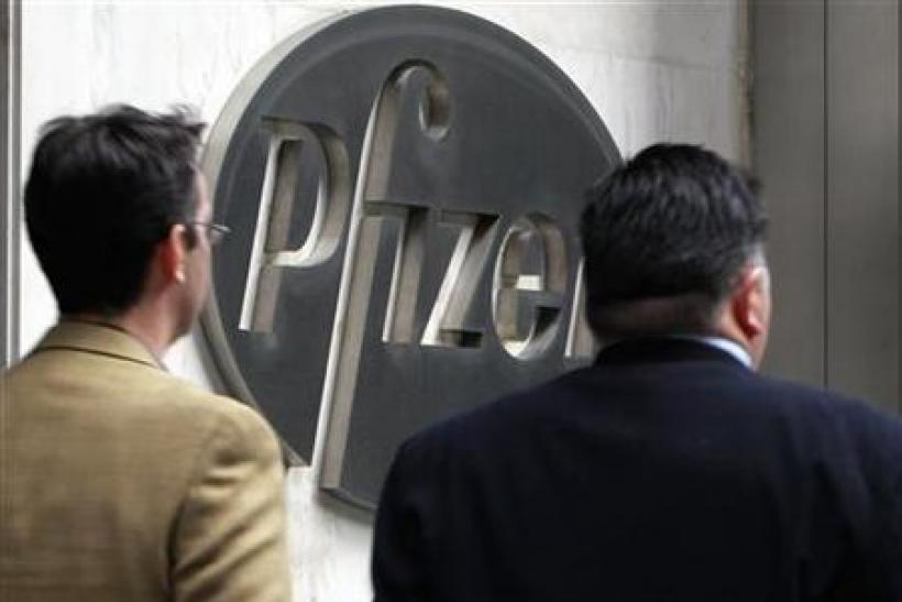 People walk past the Pfizer World headquaters in New York