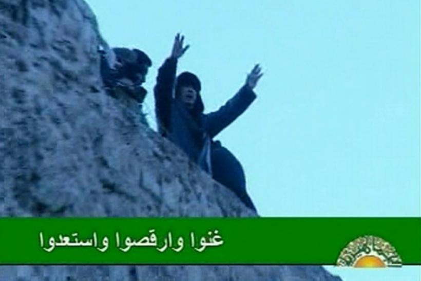 Libyan leader Muammar Gaddafi addresses his supporters in Tripoli's Green Square in this still image taken from video