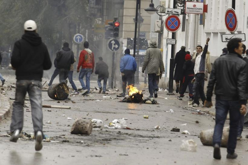 Anti-government protesters clash with riot police in downtown in Tunis