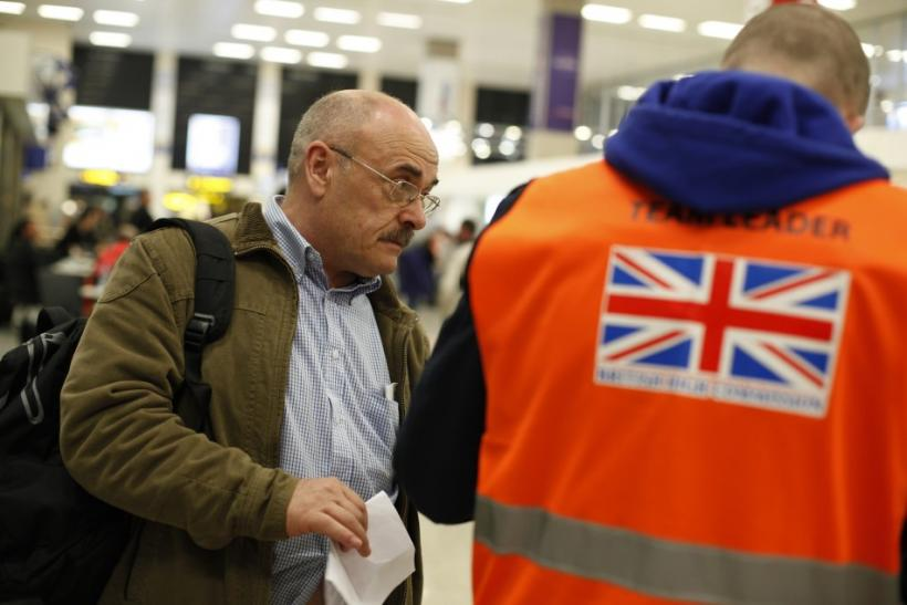 British evacuee is welcomed by a British High Commission representative after arriving at Malta International Airport outside Valletta