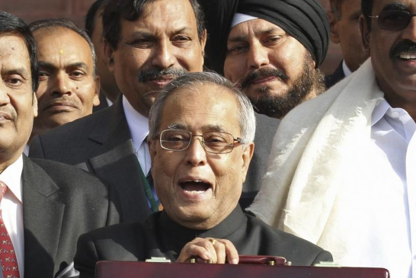 India's Finance Minister Pranab Mukherjee speaks as he leaves his office to present the 2011/12 federal budget in New Delhi February 28, 2011.
