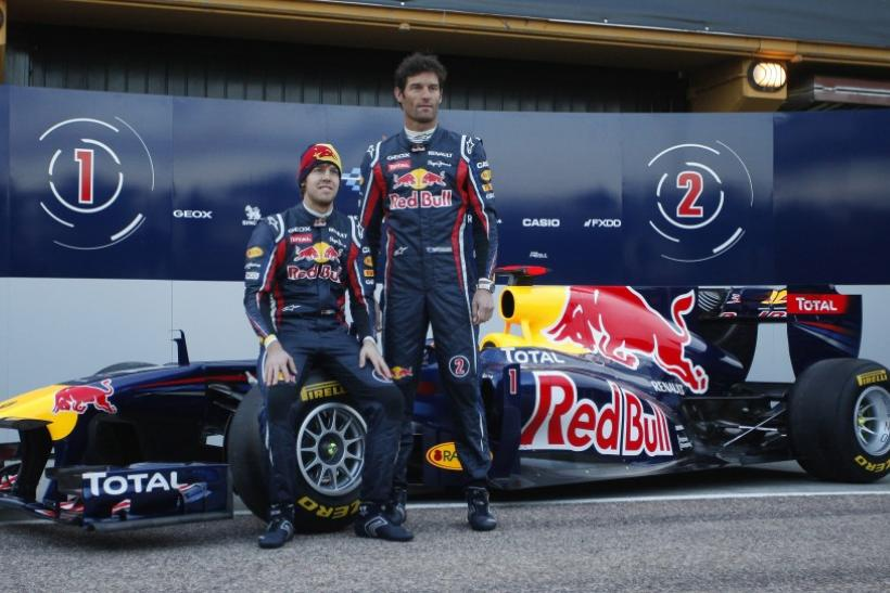 Red Bull Formula One drivers Mark Webber and Sebastian Vettel unveil the RB7 during the presentation of the 2011 Red Bull team in Valencia.